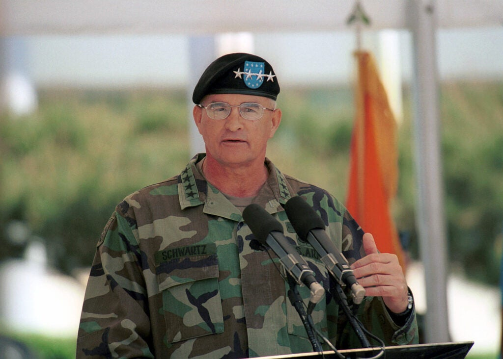 Army general giving a speech. The podcast discusses several leaders like him