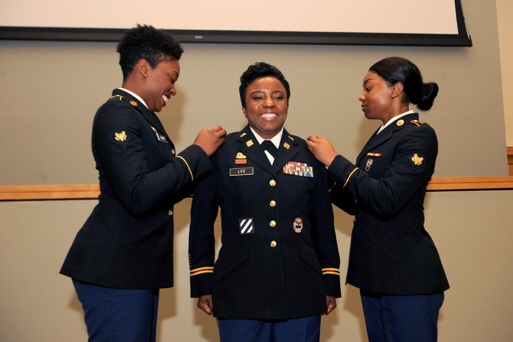 military woman getting promoted