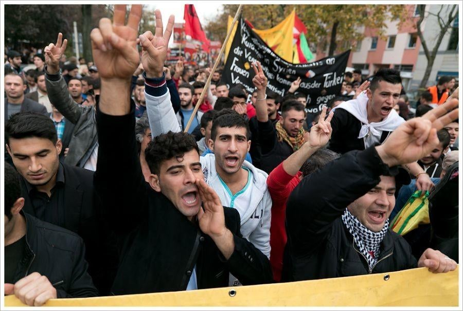 People rising up to protest ISIS