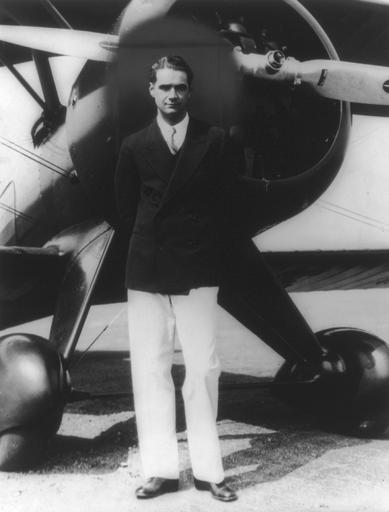 Howard Hughes in front of a sea plane