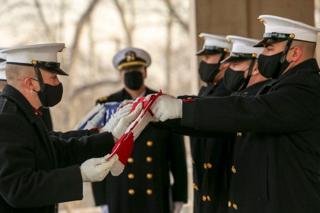 Photo of body bearers folding the flag of Brig. Gen. James R. Joy.