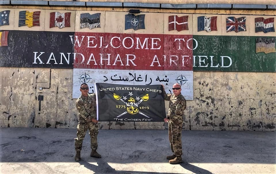 Photo of soldiers in front of Kandahar Airfield