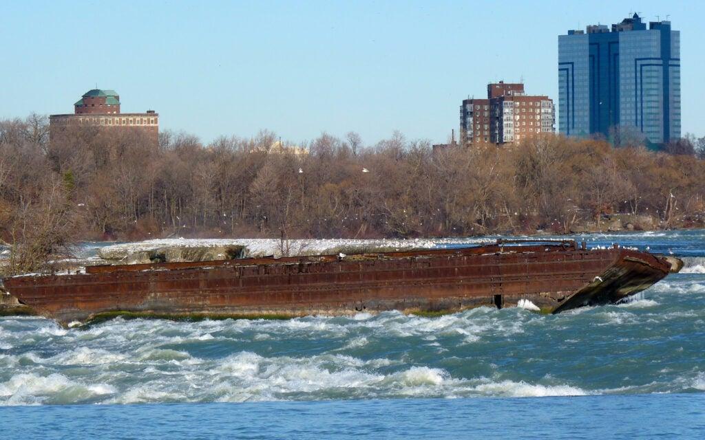 The rusted hull of a scow at Niagara Falls.