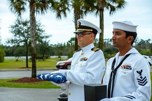 Air Force members honoring a veteran at his funeral