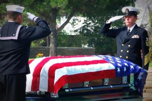 servicemen providing funeral honors