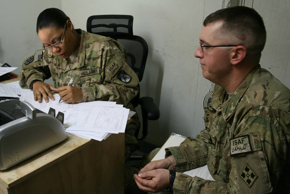 active duty troops working in office