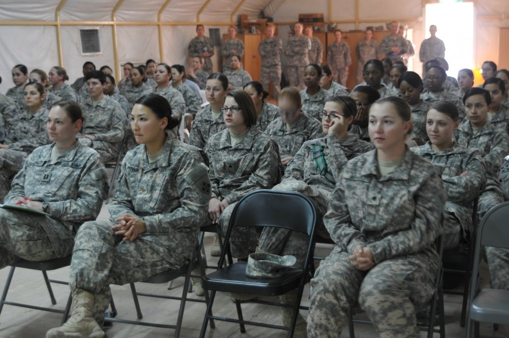 soldiers on active duty at a meeting