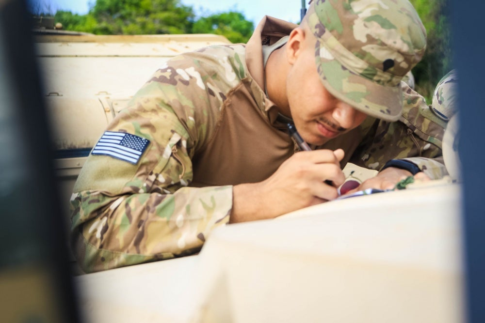 soldier filling out paperwork pretending to be dumb
