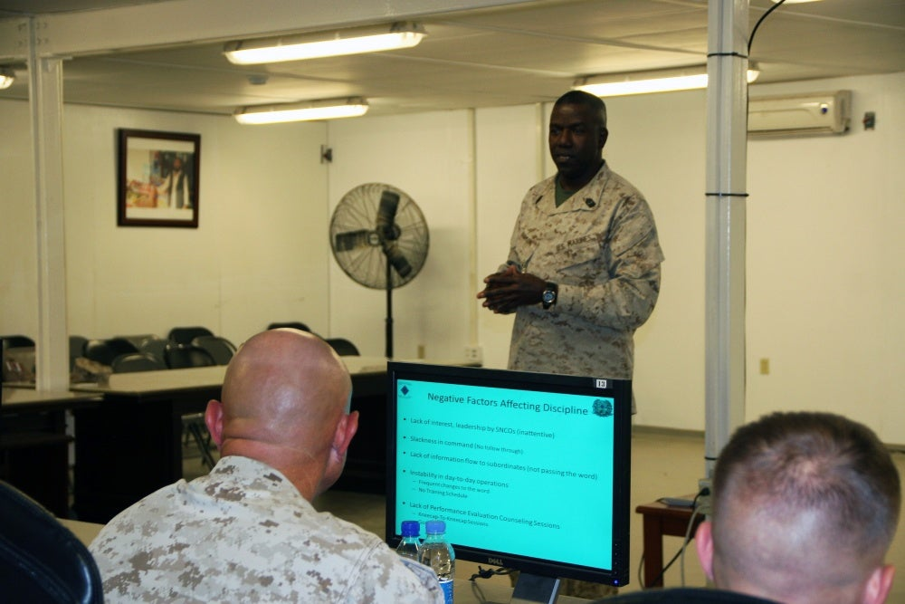 Soldier giving powerpoint presentation, Pretend to be dumb to avoid these