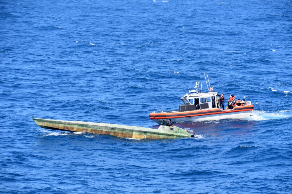 Coast Guard Cutter Bertholf (WMSL 750) boarding teams interdict a low-profile vessel in the Eastern Pacific Ocean, seizing more than 4,380 pounds of cocaine
