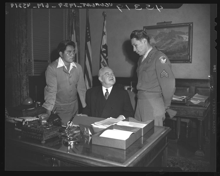 Captain Ira Hayes meeting the LA mayor after the flag raising in Iwo Jima