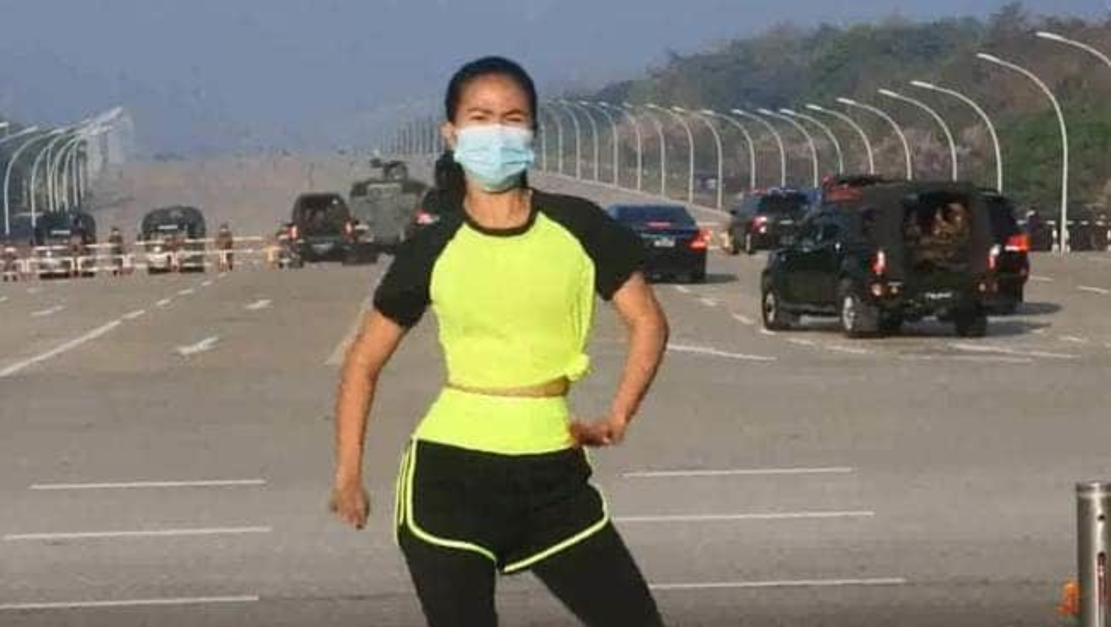 Aerobics instructor in front of coup