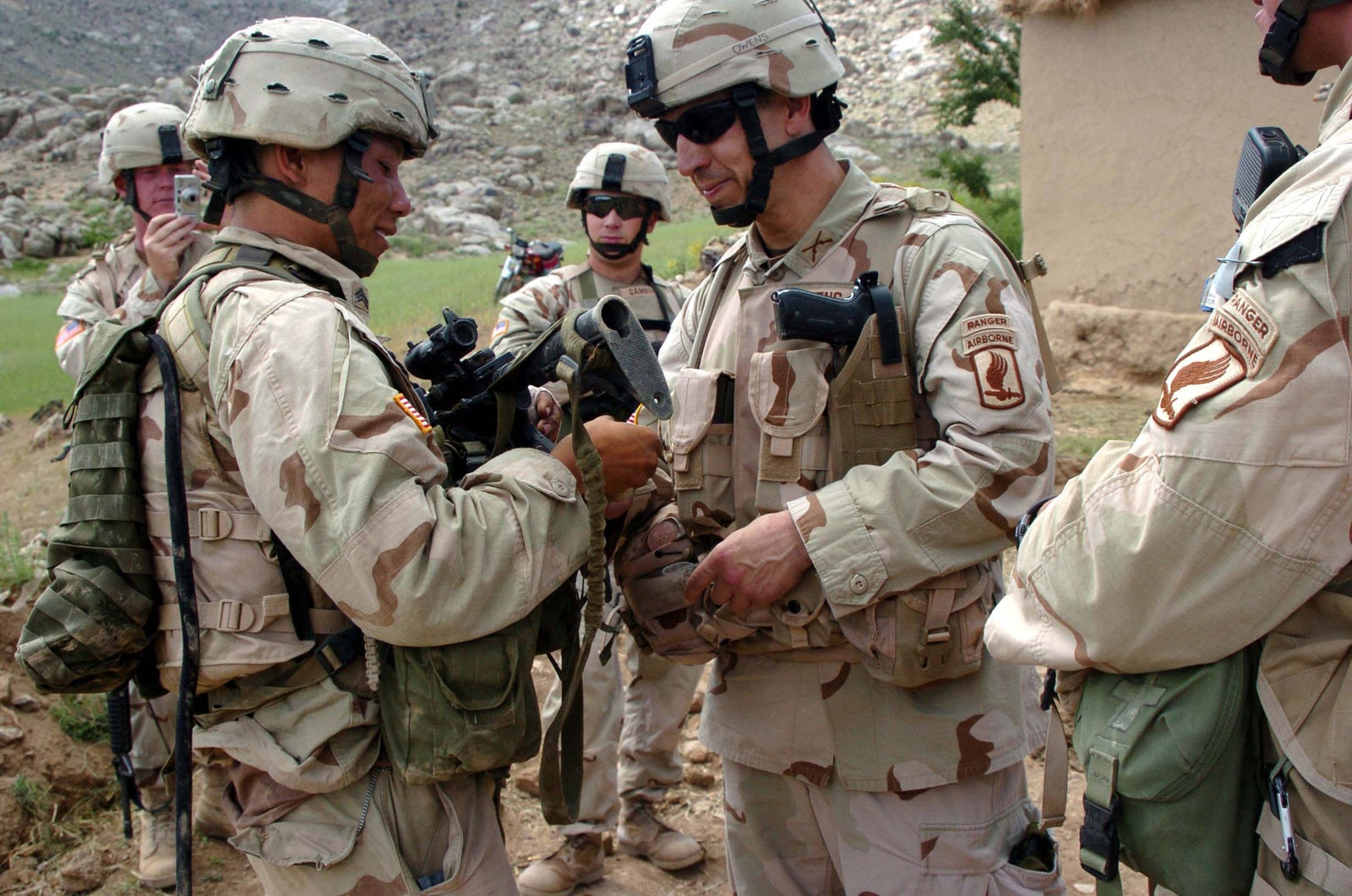 Soldiers talking. Military lingo is a tradition