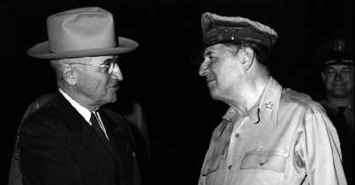 President Truman and General MacArthur shake hands