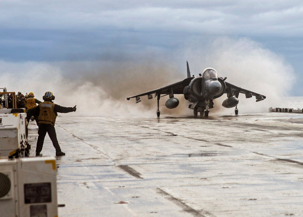 This Marine pilot makes landing his jet on a stool look easy