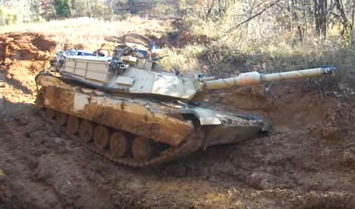 This poor Abrams tank got stuck in the mud — then got un-stuck