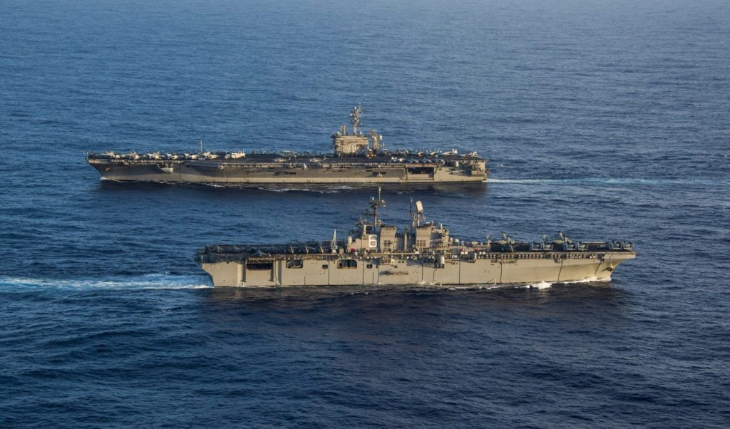The Navy's amphibious assault ships can be emergency carriers
