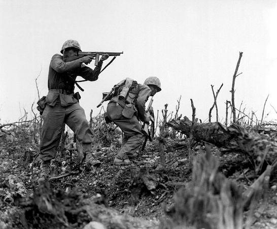 Soldiers fire a Thompson machine gun