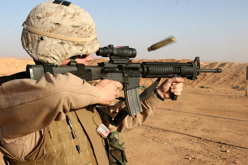 A Marine fires his M16 weapon