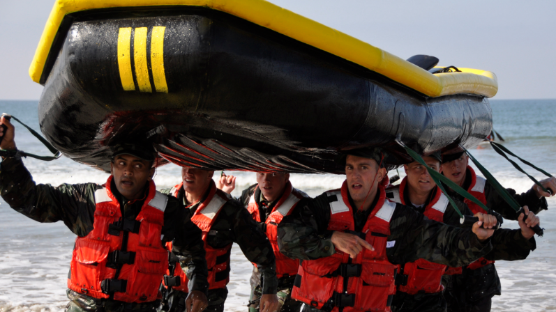 Students in BUD/S training class 279 participate in a surf passage exercise during the first phase of training at Naval Amphibious Base Coronado.  (Photo by MC2 Kyle D. Gahlau)