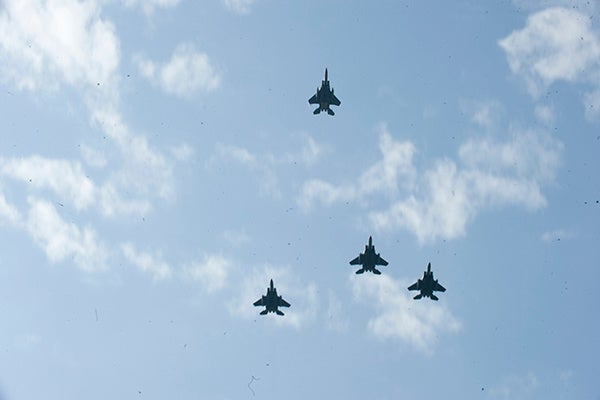 Four F-15E Strike Eagles conduct a missing man formation