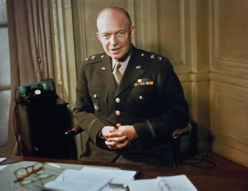 See Eisenhower tour the graveyard of D-Day 20 years later