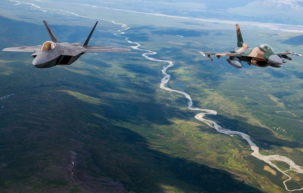 Check out these amazing photos of F-22s and F-16s flying over Alaska